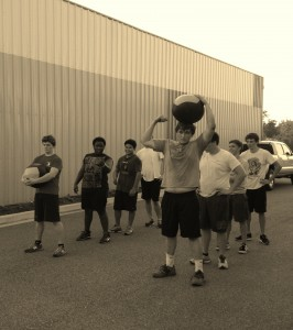Brunswick High and Glynn Academy working together to complete a 1 mile med-ball run...that is teamwork, nice work!!